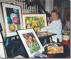 Sandy G with paintings 2