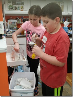 Olivia and Damian using flour to creat their objects